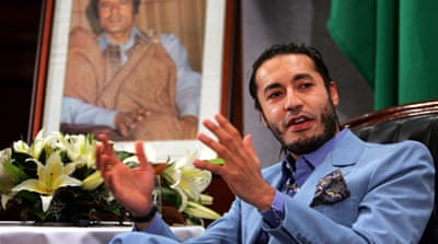 Trial begins for Gaddafi sons and officials