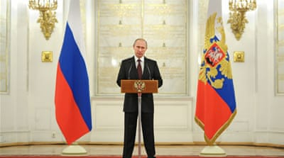 Putin congratulated the Russian armed forces for their role in the takeover of Crimea [AFP]