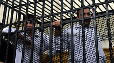 Policemen Mahmoud Salah Mahmoud and Awad Ismail Suleiman were accused of manslaughter and of torturing Khaled Said in June 2010 [AP]