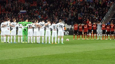 Shakhtar Donetsk players observe a minute of silence in tribute to those who died in the Ukraine clashes [AFP]
