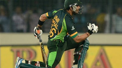 Umar Akmal hit the winning runs to set up a final against Sri Lanka on the same ground on Saturday [AFP]