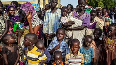 About 250,000 people have fled to neighbouring countries, including Uganda, Ethiopia, Kenya and Sudan  [AP]