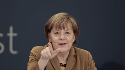 Merkel's visit sought to mark the economic upturn of a nation whose economy has been in the doldrums [Reuters]