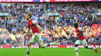 Per Mertesacker (L) scored Arsenal's equaliser in normal time [AFP]
