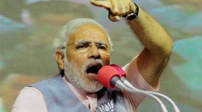 Critics fear Modi's nationalist rhetoric could fuel religious tensions between Hindus and Muslims [EPA]