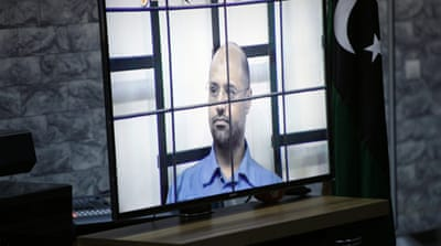 Saif al-Islam was said to be smiling and looking confident during court proceedings [Reuters]