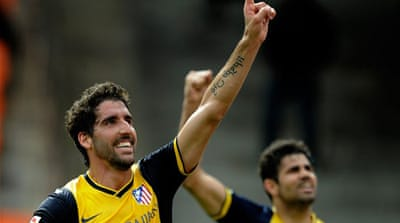 Top-placed Atletico move six points clear of Real Madrid who have a game advantage [AFP]