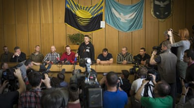 Ukraine separatists parade seized observers