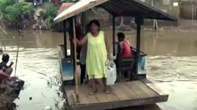 Jakarta widens rivers to stop floods