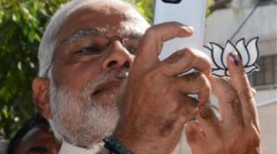 Authorities have sought action against media that broadcast Modi's address while the voting was under way [AFP]