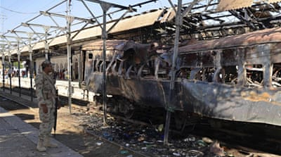 The explosion destroyed one of the train's compartment and caused big fire. [AFP]