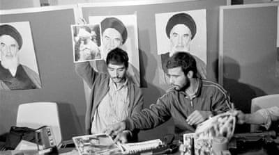 An Iranian student holds up a portrait of a blindfolded US hostage during a news conference in Tehran in 1979 [AP]