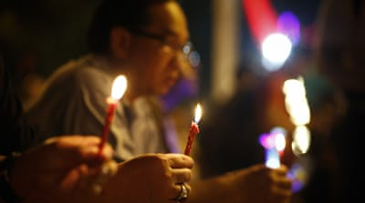 Families of MH370 passengers mark one month