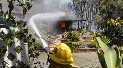 Homes were burned amid a Southern California heat wave that sparked several blazes [AP]
