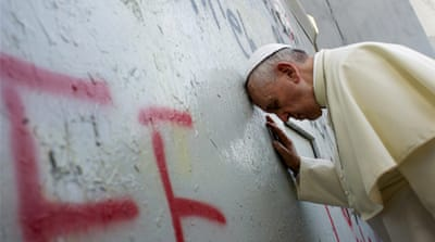 Pope prays for peace at separation wall