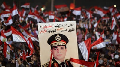 At least 1,400 people have been killed in street clashes since Morsi was ousted last July [Reuters]
