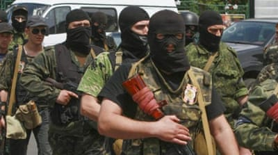 Russian-led rebels dig in for Ukraine attack