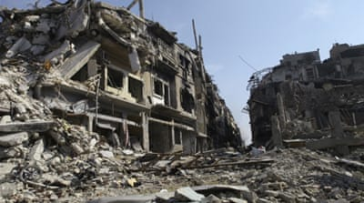 Residents endure devastation in Syria's Homs