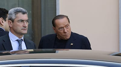 Italy's Berlusconi begins community service