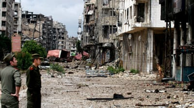 Hundreds return home to Syria's Homs
