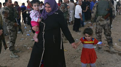 Iraqis flee Mosul after fighters seize city