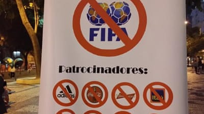 Protests gather against FIFA exclusion zones