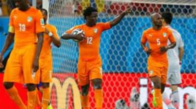 Ivory Coast scored two goals in two minutes to shock the Japanese [Reuters]
