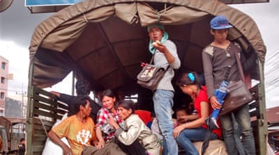 Some Cambodian migrants have been deported from Thailand in locked police trucks [Abby Seiff/Al Jazeera]
