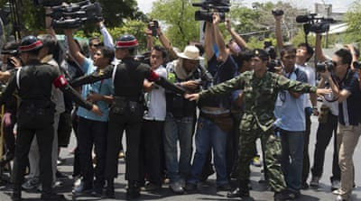 Journalist Pravit Rojanaphruk poses for a photograph before reporting to the ruling military [AP]