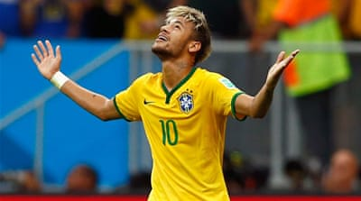 Neymar leads Brazil into last-16 and tops the goal scoring charts with four goals [GALLO/GETTY]