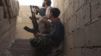 HRW based its report on interviews with 25 current and former child soldiers in Syria [AFP]