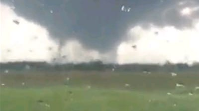 Tornadoes sweep across the Midwest leading to violent storms through parts of Ohio and Indiana [Tyler Kuester]