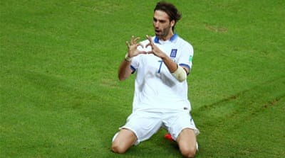 Georgios Samaras slotted in the spot kick for a win that puts Greece through to the knockout stage [GALLO/GETTY]