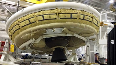 Mars 'flying saucer' splashes back to Earth