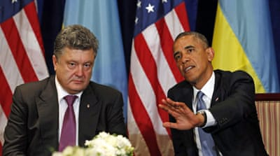 Obama and Putin traded barbs as violence continued in Ukraine's east [AFP]