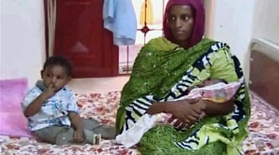 Mariam Ibrahim's son is living with her in jail, where she gave birth to a second child last week [AP]