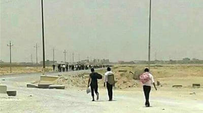 Hundreds of students and staff were evacuated from the university building to a safe place [EPA]