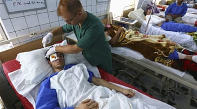 Injured from the village of Muwafaqiya received treatment in a hospital in Erbil [Reuters]