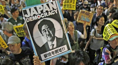 Japan to ease army ban on fighting overseas