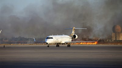 Fighting between rival militias wrecked 11 civilian planes at Tripoli's airport and damaged the control tower [Reuters]