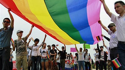 Activists called for understanding and tolerance of sexual minorities at a gay pride parade in Changsha in 2013 [EPA]