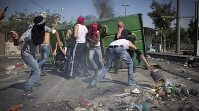 In Pictures: Clashes follow Jerusalem funeral