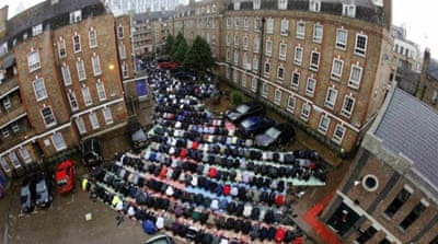 Muslims attend Friday prayers on a rainy first day of Ramadan in East London [Reuters]