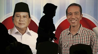 Indonesia's Prabowo Subianto (centre) is supported by hard-line groups, but his campaign states a commitment to pluralism [Al Jazeera]