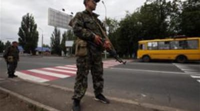Rebel fighters from towns taken over by the Ukrainian army were seen milling around central Donetsk [Reuters]