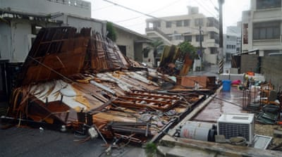 Japan urges evacuation as typhoon moves in