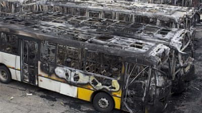 At least 20 buses were destroyed and others were damaged.  [AP]