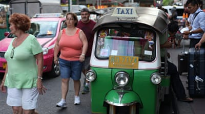 A warning issued to foreigners who have overstayed by more than 90 days states they would be banned from Thailand for between one and ten years [Steve Finch/Al Jazeera]