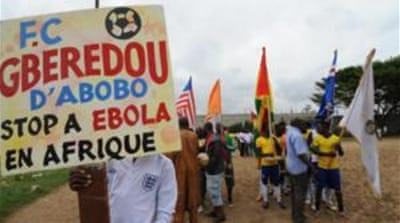 ''Stop ebola in Africa'' was the message prior to a football tournament that gathered youth from Guinea [AFP]