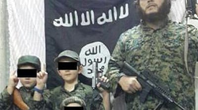 Australian man Khaled Sharrouf earlier posted a picture with his sons in front of an Islamic State flag [Twitter]